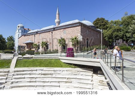 PLOVDIV BULGARIA - JULY 30: Tourists pass along Old Mosque in Plovdiv on July 30 2017 Bulgaria.