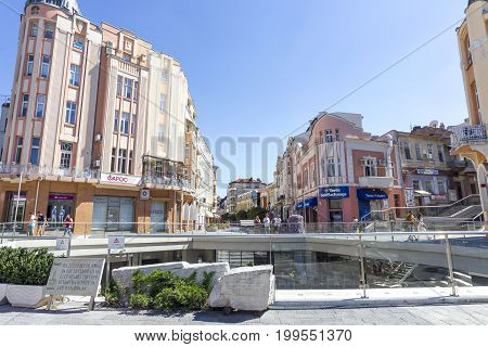 PLOVDIV BULGARIA - JULY 30: Tourists pass along ancient Roman stadium and old buildings in Plovdiv on July 30 2017 Bulgaria.