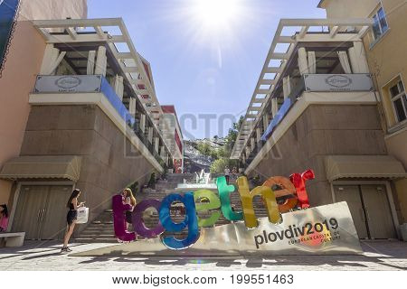 PLOVDIV BULGARIA - JULY 30: Tourists pass along European Capital of Culture 2019