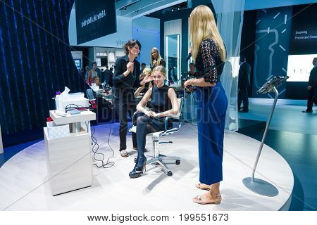 BERLIN - SEPTEMBER 04 2015: Stand of by Panasonic. Stylists and makeup artists at work. International radio exhibition Berlin (IFA2015).