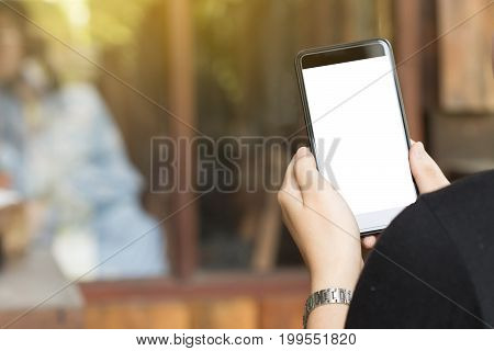 Blank screen mobile on woman hand business concept. mock up