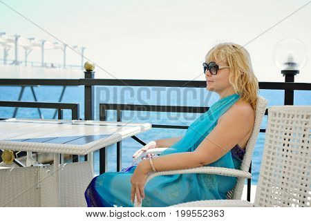 middle aged woman relaxing near the sea
