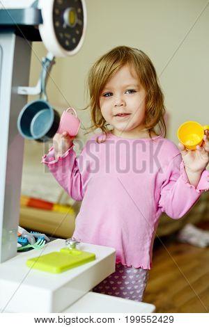 Toddler Girl Playing Kitchen