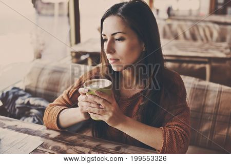 pretty woman in cafe with morning coffee