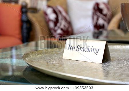 no smoking sign on table in hotel lobby