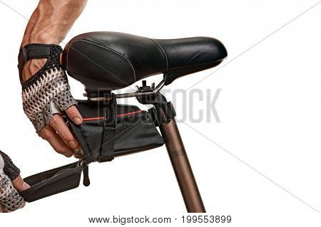 Close up photo of bicycle bag healthy male athlete preparing for biking