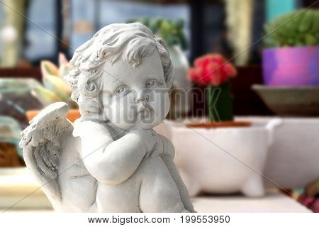 Statue Of An Cute Infant Angel