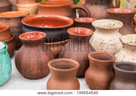 Pots and pottery earthen sauceres. Ceramic dishes, tableware and jugs