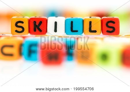 the colorful alphabet word cube of SKILLS