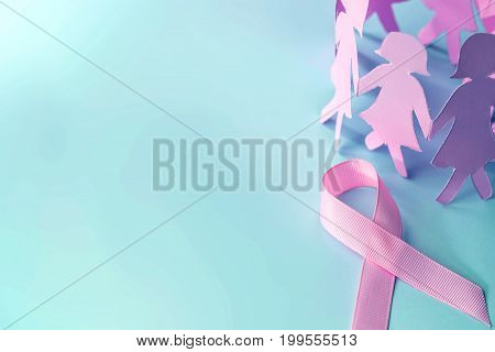 Sweet pink ribbon shape with girl paper doll on blue background for Breast Cancer Awareness symbol to promote in october month campaign