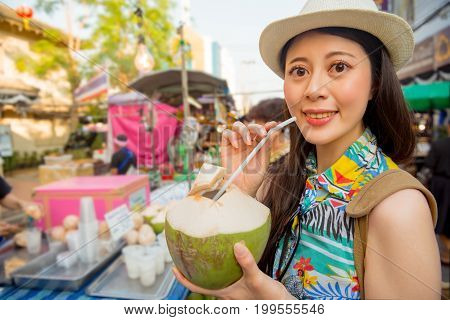 Woman Holding Coconut Water On The Thailand