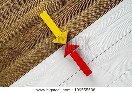 Two arrows pointing to each other. Two wooden arrows red and yellow.