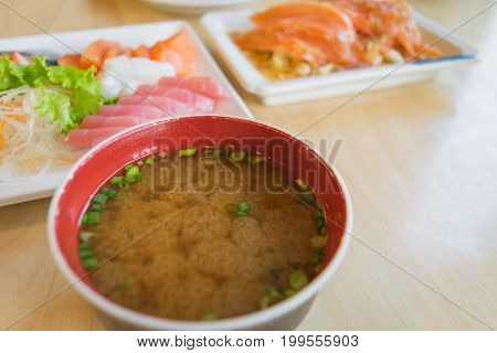 miso soup and blur other salmon fish raw on table wood in restuarent
