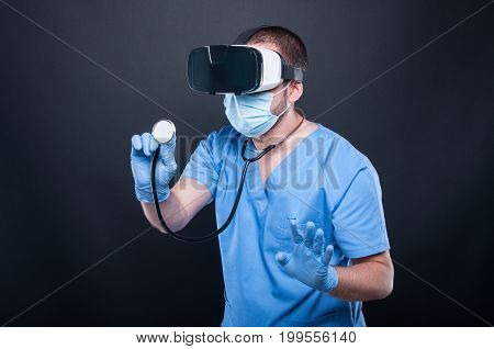 Doctor Wearing Scrubs Using Virtual Reality Glasses And Stethoscope