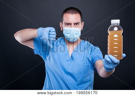Medic Wearing Face Mask Showing Polluted Water And Dislike