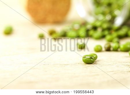 close up the green mung beans on wood plate