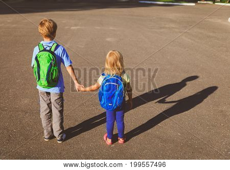 little boy and girl holding hands go to school, back to school