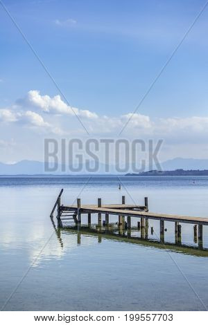 An image of an idyllic wooden jetty Starnberg Lake