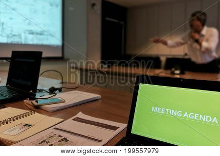 computer display in a dark tone meeting room. Close-up of computer notebook display in a Business meeting room
