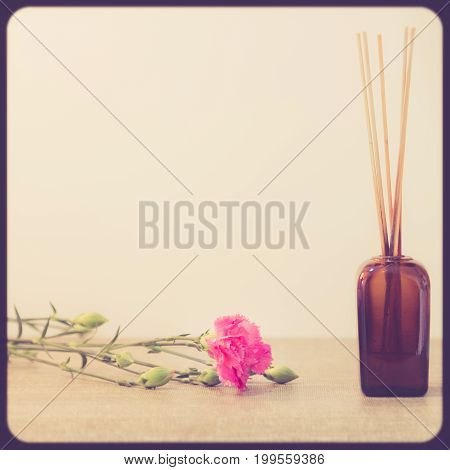 Bright Pink Carnations Flower On Table With Wood In The Japanese Glass Vase. Vintge Image Style