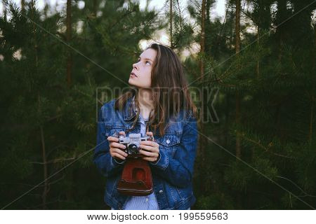Woman Hand Holding Retro Camera. Young Hipster Girl Photographer With Film Camera. Young Woman Photo