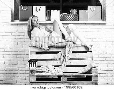 Woman Sits On Sofa