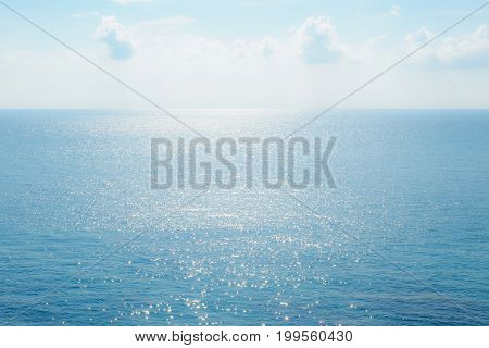 Clear Blue Sky And Sea Surface Sparkling.