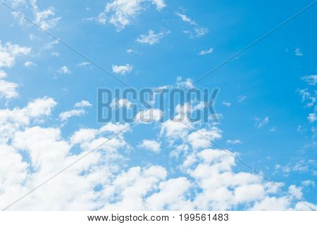Clearly summer blue sky with white clouds in bright morning.