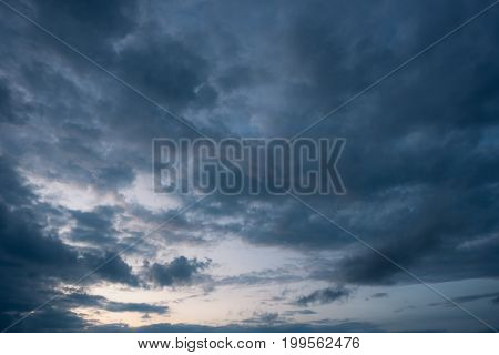 Dark cloud and blue sky storm background with cloudy before rain storms.