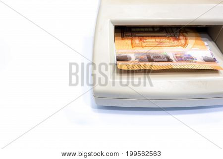 Fifty Euro Banknote In Automatic Counterfeit Money Detector On White Background.