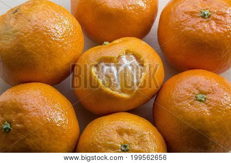 Orange mandarins and one with a hole in form of heart