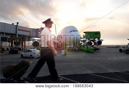 Commercial aircraft pilot walking during arrival with blur motion