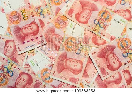Many of one hundred Chinese yuan banknotes Chinese currency as background.