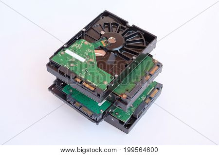 Several Hard drive isolated on a white HDD disk