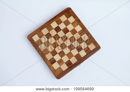 Folded chess board isolated over the white background.