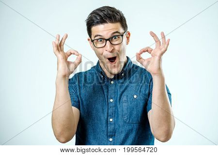 Handsome Man In Jeans Shirt Showing Ok Sign