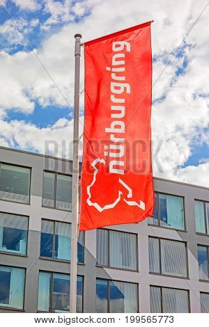Nurburg Germany - May 20 2017: Flag at race track Nurburgring info center entrance labeled with