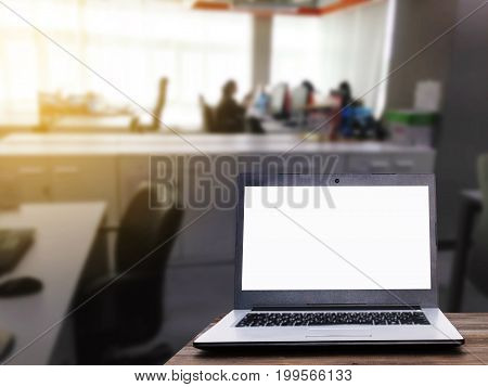 Laptop computer with white blank screen for advertising on wooden desk with blur business office working space background copy space business working online social media searching data concept