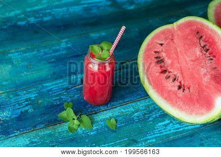 Resh Watermelon Juice With Mint In A Jar With A Straw On A Blue Wooden Table