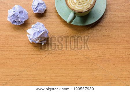 Crumpled paper with blue cup coffee.Concept stress