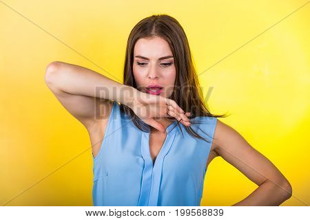 Pretty Woman Standing Against Bright Background