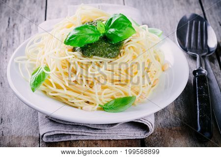 Spaghetti With Homemade Pesto Sauce, Olive Oil, Pine Nuts And Basil Leaves
