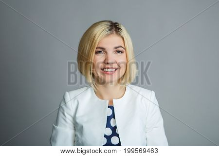Portrait of beautiful young woman on empty gray background