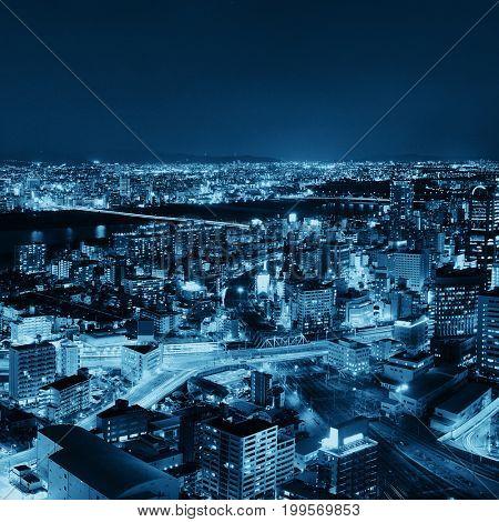 Osaka urban city at night rooftop view. Japan.