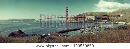 Golden Gate Bridge panorama in San Francisco with bay and boat