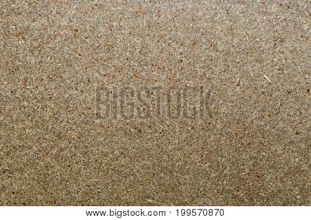 Surface texture of chipboard (chipboard) in brown color