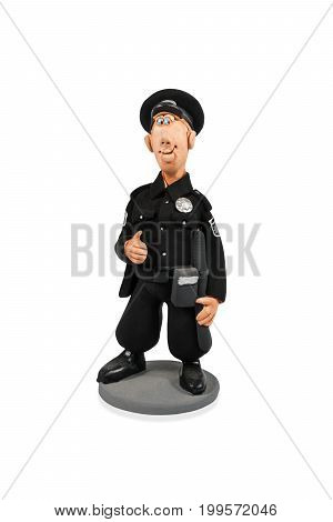 Clay statuette of smiling policeman in black uniform isolated on white background