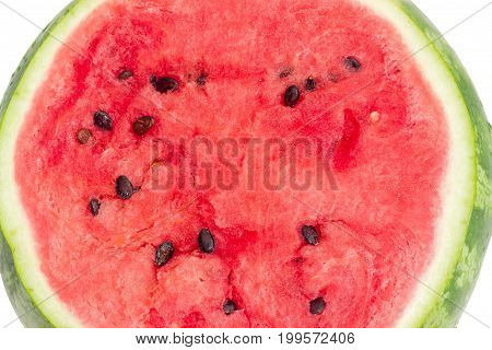 Background of a cut of the watermelon with deep red flesh and seeds on a white background