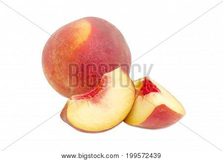 One whole ripe fresh peach and two peach slices on a white background