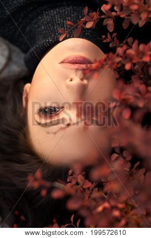 Autumn Woman Portrait. Beauty Fashion Model Girl with Autumnal Make up. Fall.
